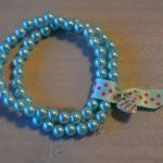 dubbele armband turquoise stippen lintje
