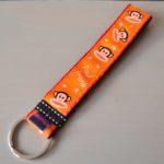 polscord oranje paul frank band handig nooit je sleutels kwijt handen vrij kado cadeautje